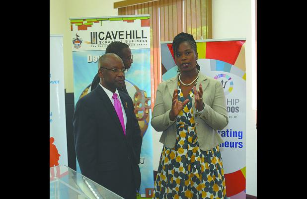 General Manager of the Barbados Youth Business Trust, Cardelle Fergusson, having a word with Minister of Culture, Sports and Youth Stephen Lashley (left) at the event.