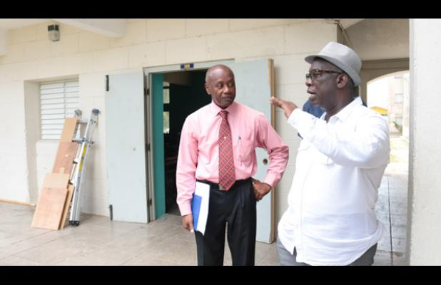 While on a tour of several schools in various stages of renovation, Ronald Jones, spoke with Principal of the Combermere School, Vere Parris. (BGIS)