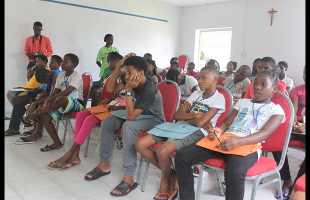 Some of the participants in Project S.O.F.T 2016, listening attentively during the talk on 'Adolescent Development & Sexuality' by Youth Development Officer/ Social Worker with the Barbados Family Planning Association, Keriann Hurley (INSET).