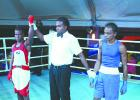 Barbados' Jabali Breedy triumphs over his Guyanese opponent Kevin Allicock in the Men's Elite Caribbean Development Boxing Tournament at the Sea Rock Dome on Saturday.