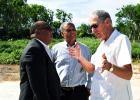 Minister of Agriculture, Food, Fisheries and Water Resource Management, Dr. David Estwick (left) chatting with Chairman of Williams Industries Limited, Ralph 'Bizzy' Williams (right) and Deputy Chairman of the BWA, Henry Barrow.