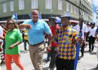 CEO of the Barbados Tourism Product Authority (BTPA), Dr. Kerry Hall (second left) and Acting Prime Minister and Minister of Tourism and International Transport, Richard Sealy (second right) making their way down Broad Street during the Tourism Workers' Parade.