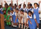 Students of the St. Paul's Primary School performing a just-penned tribute with the accompaniment of the Mighty Gabby.