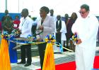 From left to right: Chief Executive Officer of the BPI, David Jean-Marie; Parliamentary Secretary in the Ministry of Tourism and International Transport, Senator Irene Sandiford-Garner; and Chairman of BPI, David Harding, cutting the ribbons officially commissioning Berth 5 at the Bridgetown Port yesterday.