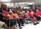 Barbados Labour Party supports gathered for the joint meeting held at George Lamming Primary School. INSET: Barbados Labour Party candidate for St. Michael South Central, Marsha Caddle, addressing the joint meeting.