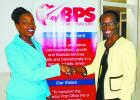 Top graduate, Jacinta Browne (left) being congratulated by Deputy Postmaster General, Int'l Postal Affairs and Business Development, Margaret Ashby.
