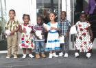"""The children of the Joan Arundell Day Nursery recited """"Train up a Child""""."""