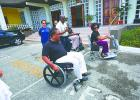 Finding no wheelchair ramp into Government Headquarters' front entrance, some members of the Barbados Council for the Disabled had no choice but to head around the building for access in order to deliver the petition.