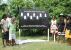 From right: BRSA volunteer, Paulavette Atkinson, with BRSA President and family members of those who lost loved ones in road fatalities, including Sharon Straughn and (from left) Nicholas Noel, his son Donae Noel and mother Judith Noel, during the unveiling of a sign to remember the lives lost this year on the highways and byways of Barbados.