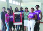 Mass Communication students posing for a picture with guest speaker, Melinda Belle of Image up by Melinda, during yesterday's launch of the 'I Am Beautiful' Campaign.