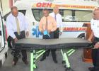 Health Minster, John Boyce taking a close look at one of the stretchers which will be inside the two new ambulances.