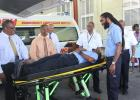 Emergency Medical Technician, Anderson Nurse, testing out one of the new stretchers. Included in those looking on are Health Minister, John Boyce, Head of the Department of Emergency Ambulance Services, Dr. David Byer (third from left) and NASSCO Sales Director, Roger Moore (second from left).