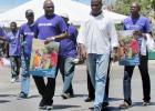 Attorney General, Adriel Brathwaite (left forefront) and other men showing their support at the March Against Child Abuse held yesterday.