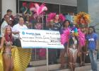 Representatives of the National Cultural Foundation collect the cheque to assist with Grand Kadooment.